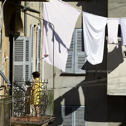bastia-Corsica-france-woman-hanging-clothes-on-a-close-line