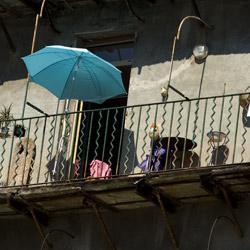 bastia-Corsica-france-blue-umbrella-on-a-balcony