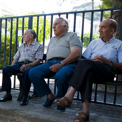 bastia-Corsica-france-three elderly-men-sitting-on-a-bench