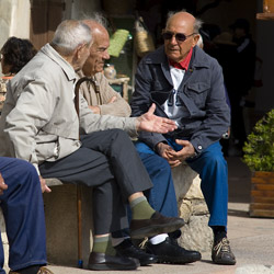 bonifacio-Corsica-france-three-old-men-sitting-on-a-bench